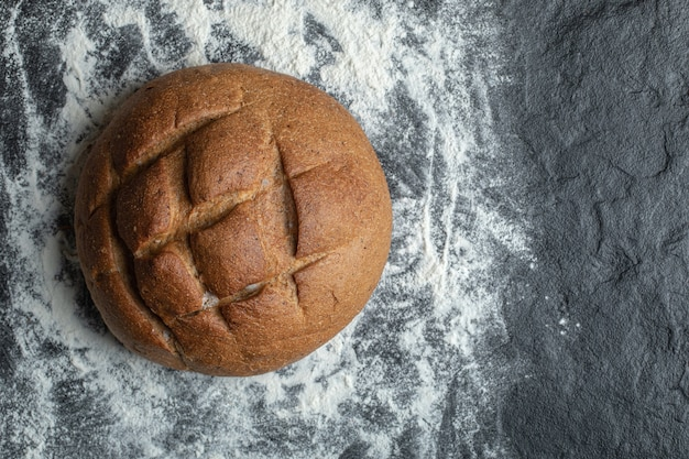 Close up photo of rye bread. on flour.