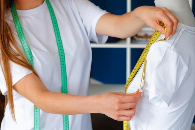 Close up photo of a seamstress at work