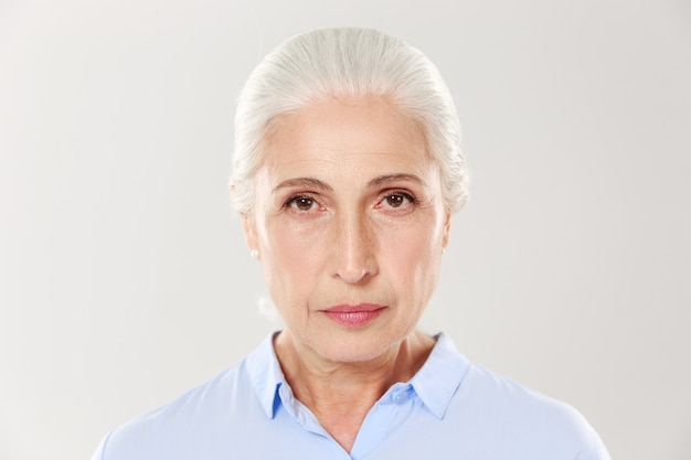 Close-up photo of serious elderly woman