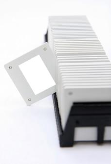 Close up photo slide films on rack projector reel vintage.
