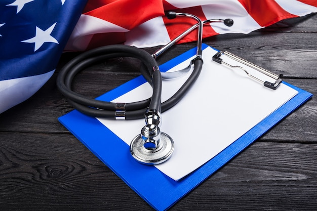 Close-up photo of stethoscope onmerican usa flag