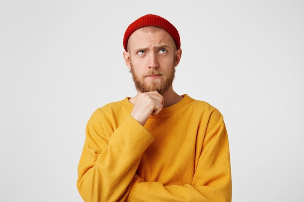 Close up photo of thoughtful man looking aside isolated over white wall