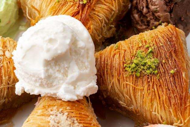 Close up photo of turkish baklava served with ice cream