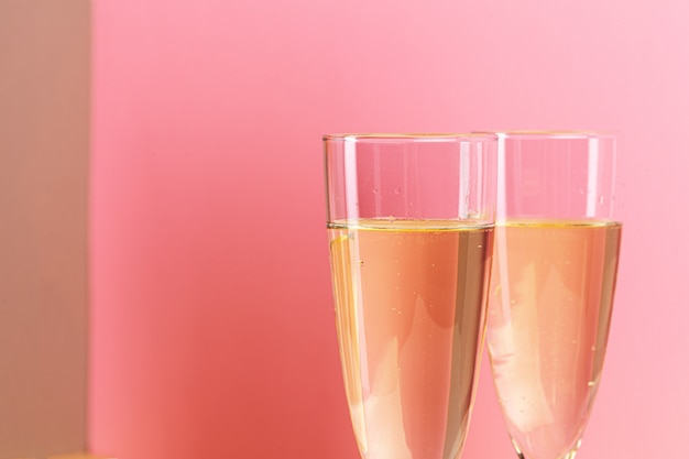 Close up photo of two champagne glasses
