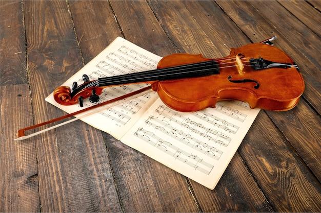 Close-up photo of violin and musical notes
