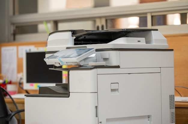 Close-up photocopier or printer multi purpose copier machine for scanning and copy paper.