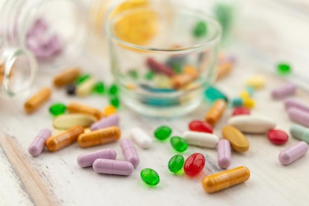 Close-up photos of capsules and vitamins