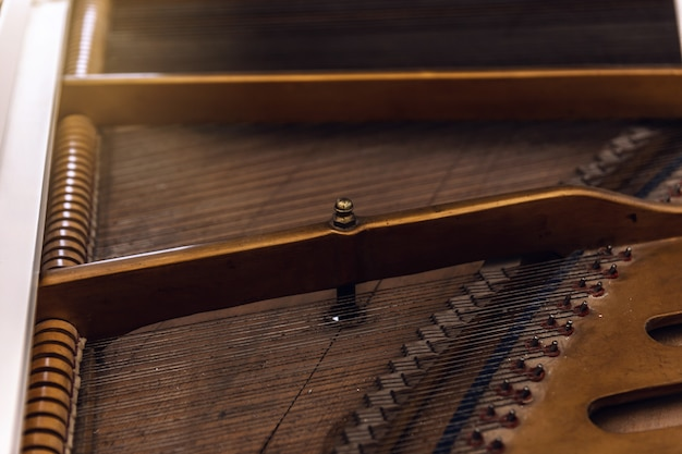 Close-up of a piano from the inside. instrument with horizontally stretched metal strings.