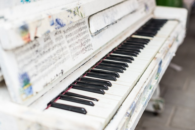 Close up of piano keys outdoors.