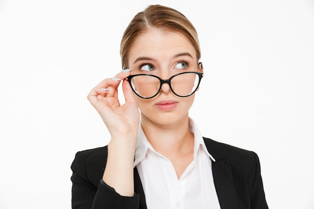Close up picture of beauty blonde business woman in eyeglasses looking away over white