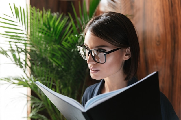 Close up picture of calm business woman in eyeglasses