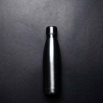 Close-up picture of eco stillness thermo bottle, of dark grey colour.