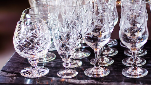 Close up picture of empty crystal wine glasses in restaurant