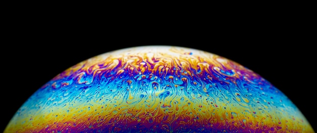Close up picture of half soap bubble on black background