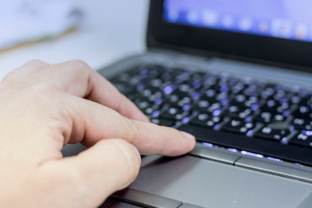 Close up picture of lady hand typing in office.