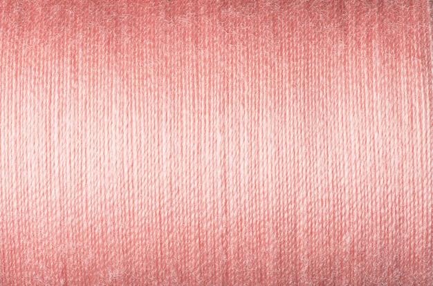 Крупным планом изображение текстуры розовой нити, поверхность фона imange
