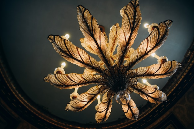 Close up the picture of the unrealistic hanging chandelier