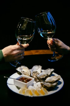 Close-up picture of women's and male hand hold a glasses of champagne