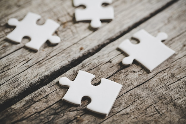 Close-up pictures of four white jigsaw puzzle pieces
