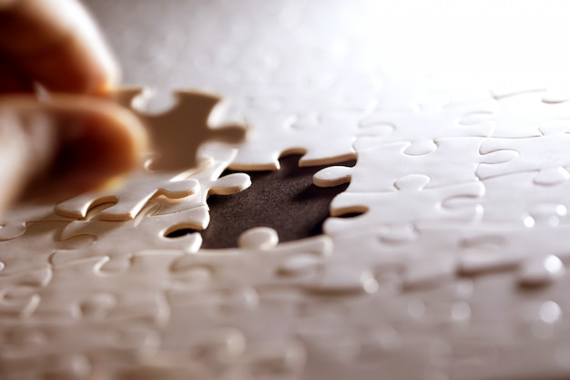 Close up piece of the white jigsaw puzzle