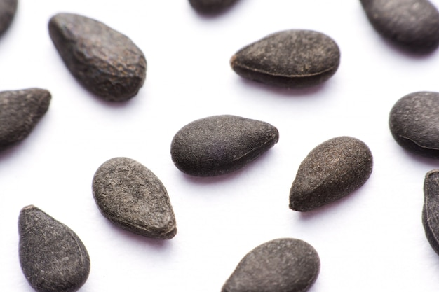 Close up pile of black sesame seeds isolated on white background