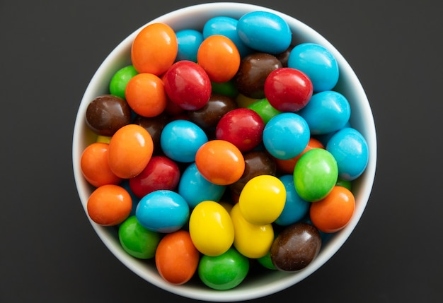 Close up of a pile of colorful chocolate coated candy, chocolate background