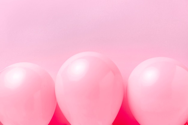 Close-up pink balloons on table