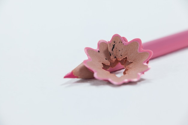 Close-up of pink colored pencil with shavings