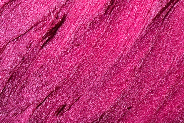 Close up of pink lipstick texture. it can be used as a background