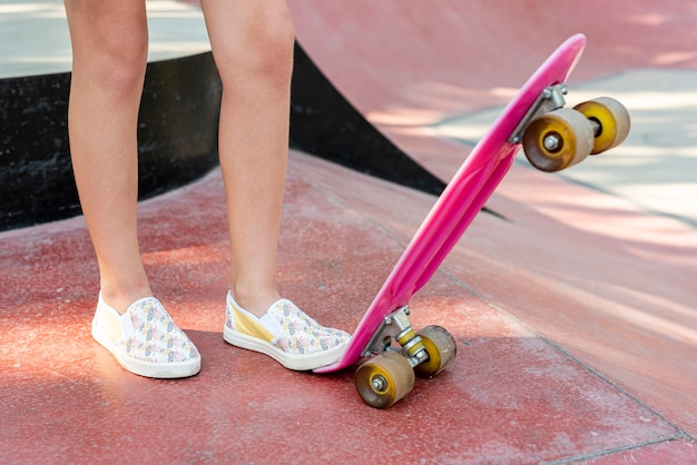Close-up of pink skateboard