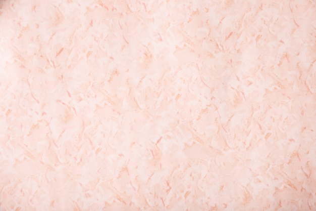 Close-up pink textured stucco wall