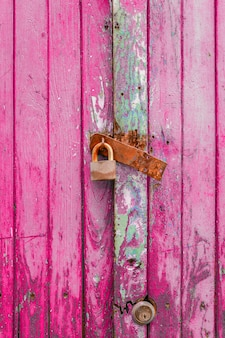 Close up of pink wooden door