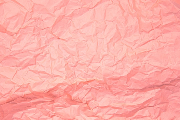 Close up of pink wrinkle crumpled old with paper page texture rough background.