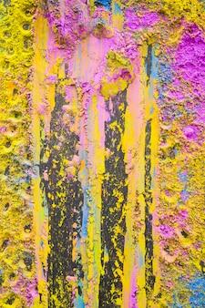 Close-up of pink and yellow holi powder backdrop