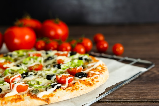 Close-up of pizza and tomatoes