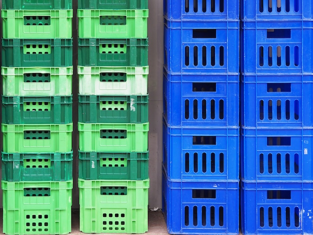 Close up to plastic baskets colorful baskets wall background.