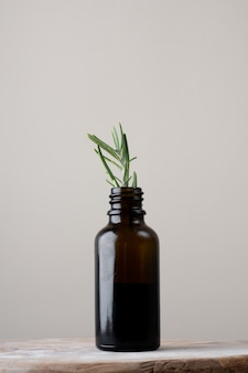 Close-up plastic bottle with rosemary