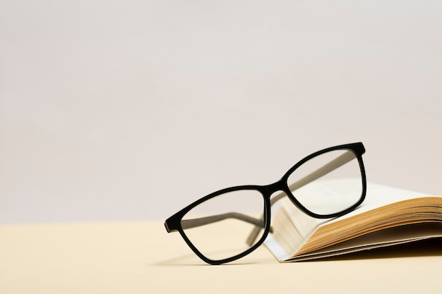 Close-up plastic eyeglasses on a book