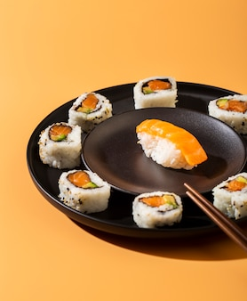 Close up plate of sushi rolls with nigiri