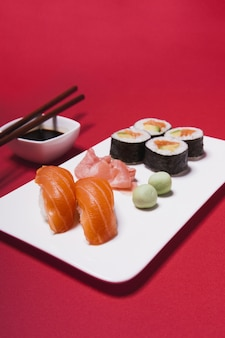 Close-up plate with sushi and condiments