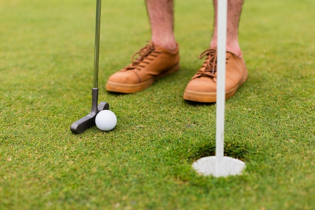 Close-up player exercising golf