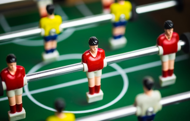 Close up of player on mini football game on table, the concept of fighting in business.