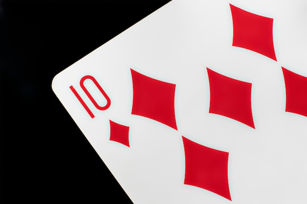 Close up playing card isolated onlackurface