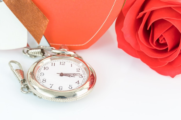 Close up pocket watch and red roses flower