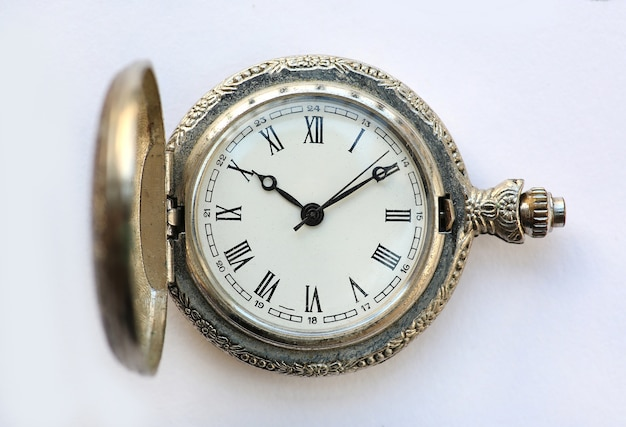 Close up pocket watch on white background