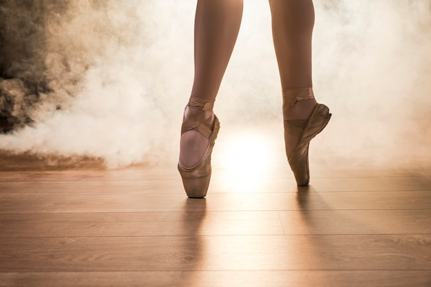 Close up pointe shoes in smoke