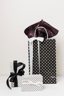 Close-up of polka dotted gift boxed and paper bag