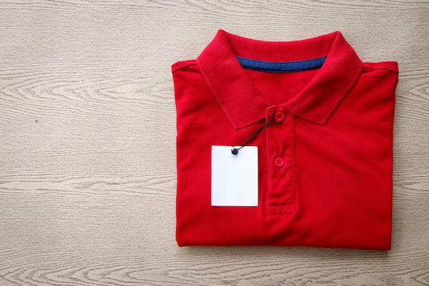 Close up polo shirt put on wooden tabletop Premium Photo