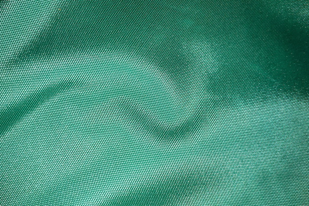 Close up of polyester textured green synthetical background