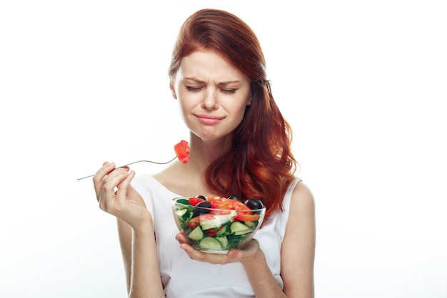 Close up pon woman eating salad isolated